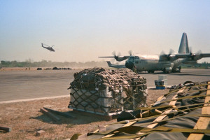 An international aid effort to rebuild East Timor after the Indonesian Army had trashed it came from as far away as Canada. This C-30 Hercules transport is delivering the first Canadian aid following the return of international aid workers in 1999. (Converted from 35mm slide)